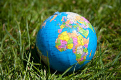 A colorful Globe on a lawn Stock Image