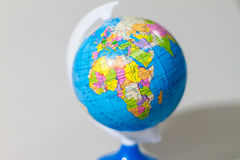 Colorful Globe on Stand with Africa Continent Royalty Free Stock Photography