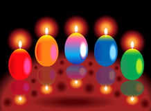 Colorful glossy burning candles Royalty Free Stock Image