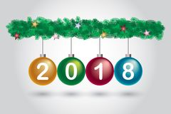 Colorful glossy Christmas ball 2018 green pine bush tree isolated. Colorful glossy Christmas ball and green pine bush tree isolated on gray background, shiny red Stock Photos