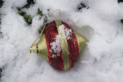 Colorful glowing christmas ball on the snow Royalty Free Stock Images