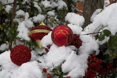 Colorful glowing christmas ball on the snow Stock Photos