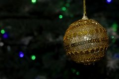 Colorful glowing christmas ball on the tree Royalty Free Stock Photos