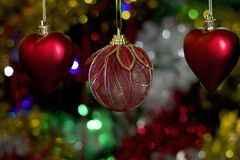 Colorful glowing christmas ball on the tree Stock Image