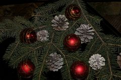 Colorful glowing christmas decorations with cones Royalty Free Stock Photography