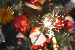 Colorful glowing christmas decorations on the tree stock image