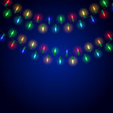 Colorful glowing christmas lights on blue background. Vector illustration Royalty Free Stock Images