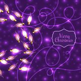 Colorful Glowing Christmas Lights on violet background Stock Photo