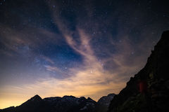 The colorful glowing core of the Milky Way and the starry sky captured at high altitude in summertime on the Italian Alps, Torino Royalty Free Stock Images