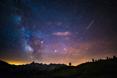 The colorful glowing core of the Milky Way and the starry sky captured at high altitude in summertime on the Italian Alps, Torino Royalty Free Stock Photography