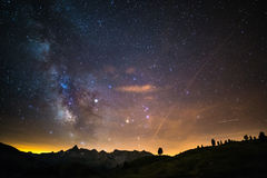 The colorful glowing core of the Milky Way and the starry sky captured at high altitude in summertime on the Italian Alps, Torino Stock Image