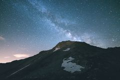 The colorful glowing core of the Milky Way and the starry sky captured at high altitude in summertime on the Italian Alps, Torino Royalty Free Stock Photos
