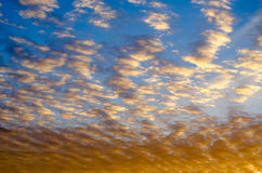 Colorful glowing golden sunset in a cloudy sky Royalty Free Stock Photography