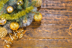 Colorful gold Christmas baubles on pine Stock Photography