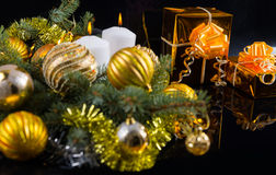 Colorful gold themed Christmas still life Stock Images