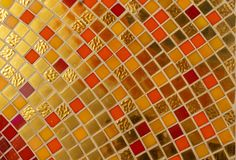 Colorful golden ceramic mosaic royalty free stock photography