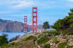 Colorful Golden Gate Bridge and Nature, Trees and Cliffs seen from San Francisco, CA. Colorful view of the Golden Gate Bridge surrounded with nature, vegetation royalty free stock photos