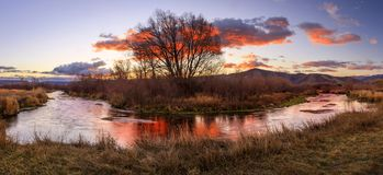 Colorful golden sunrise panorama above a stream, Utah mountains, USA. royalty free stock photography