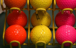 Colorful Golf Balls. Colorful Mini-golf balls in a rack Stock Image