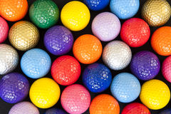 Colorful Golf Balls. Assortment of colorful mini golf balls on black Stock Photography