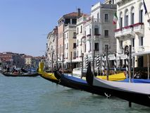 Gondolas at dock on Grand Canal in Venice, Italy, as day begins royalty free stock photo