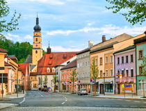 Colorful gothic houses in a german town, Germany. Old gothic house and church in the center of a german town, Dingolfing, Bavaria, Germany Royalty Free Stock Images