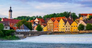 Landsberg am Lech gothic Old Town, Germany. Colorful gothic houses and waterfall in Landsberg on Lech Old Town, Bavaria, Germany royalty free stock photo