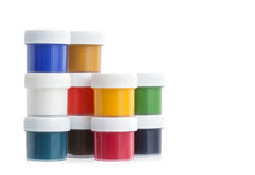 Colorful gouache paint cans isolated on white Royalty Free Stock Photos