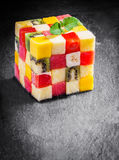 Colorful gourmet cube of diced fresh exotic fruit. Colorful gourmet cube of diced fresh tropical fruit with watermelon, melon, orange, strawberry, banana Stock Photography