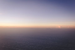 Colorful gradient sky just before sunrise view form airplane with copyspace Royalty Free Stock Photos