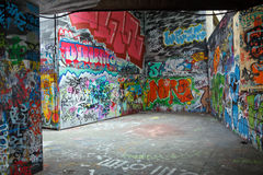 Colorful graffiti. Gray walls painted with bright colorful graffiti royalty free stock images