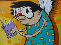 Colorful graffiti. Colorful  graffiti depicting man masquerading as Hornet Royalty Free Stock Photography