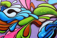 Colorful graffiti art. Detail of a colorful graffiti art on a wall, abstract background royalty free stock image