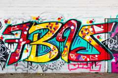 Colorful graffiti art line the street walls Stock Photo