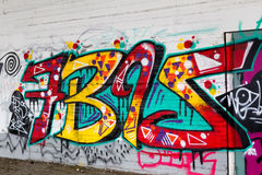 Colorful graffiti art line the street walls Stock Images