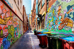 Colorful graffiti on brick walls in an alley in Melbourne, Austr Stock Image