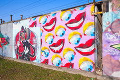Colorful graffiti with bright abstract cartoon smiles Royalty Free Stock Image