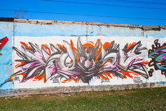 Colorful graffiti with chaotic pattern and devil portrait Stock Image