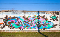 Colorful graffiti with chaotic pattern over old gray concrete ga Stock Image