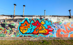 Colorful graffiti with chaotic text on gray wall Royalty Free Stock Photo