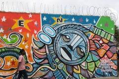 Colorful graffiti and concertina wire in Haiti. Royalty Free Stock Photo