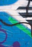 Colorful Graffiti Covers Brick Wall Stock Photo