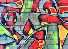 Colorful graffiti detail on a brick wall. Colorful red and green graffiti detail on a brick wall stock image