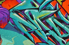 Colorful graffiti. Detail of graffiti wall, part of the city, where artists decorated the old buildings and factories walls royalty free illustration