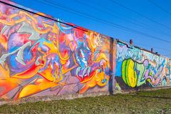 Colorful graffiti with dragon and chaotic patterns over old gra Royalty Free Stock Image