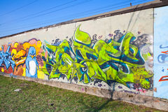 Colorful graffiti fragment with green chaotic pattern Stock Images