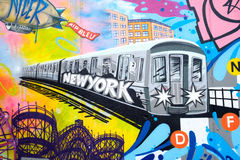 Colorful graffiti in New York City with an image of a subway tra. In and the Coney Island Rollercoaster Stock Images