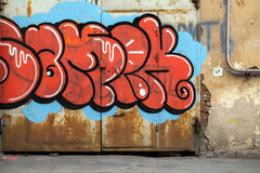 Colorful graffiti over old rusted metal gate Royalty Free Stock Image