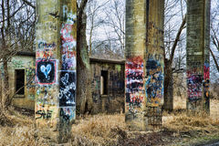 Colorful graffiti painted on columns of old concrete coal chute. Stock Images