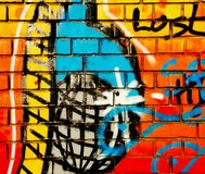 Colorful graffiti spray art on a brickstone wall stock photos